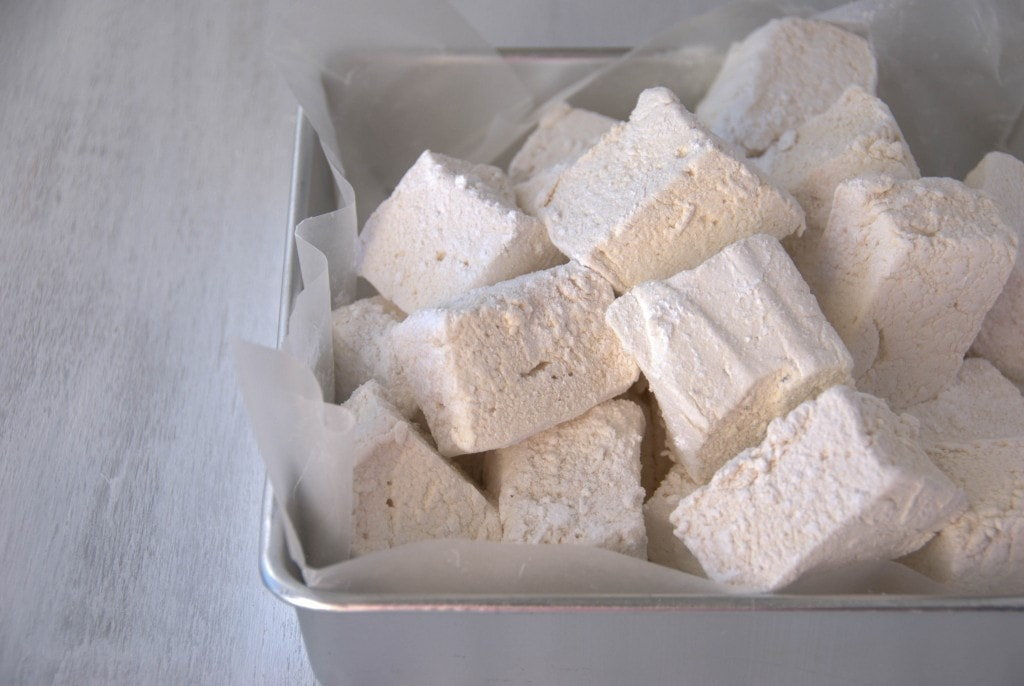 Honey Vanilla Marshmallows plied in a parchment lined silver cake pan