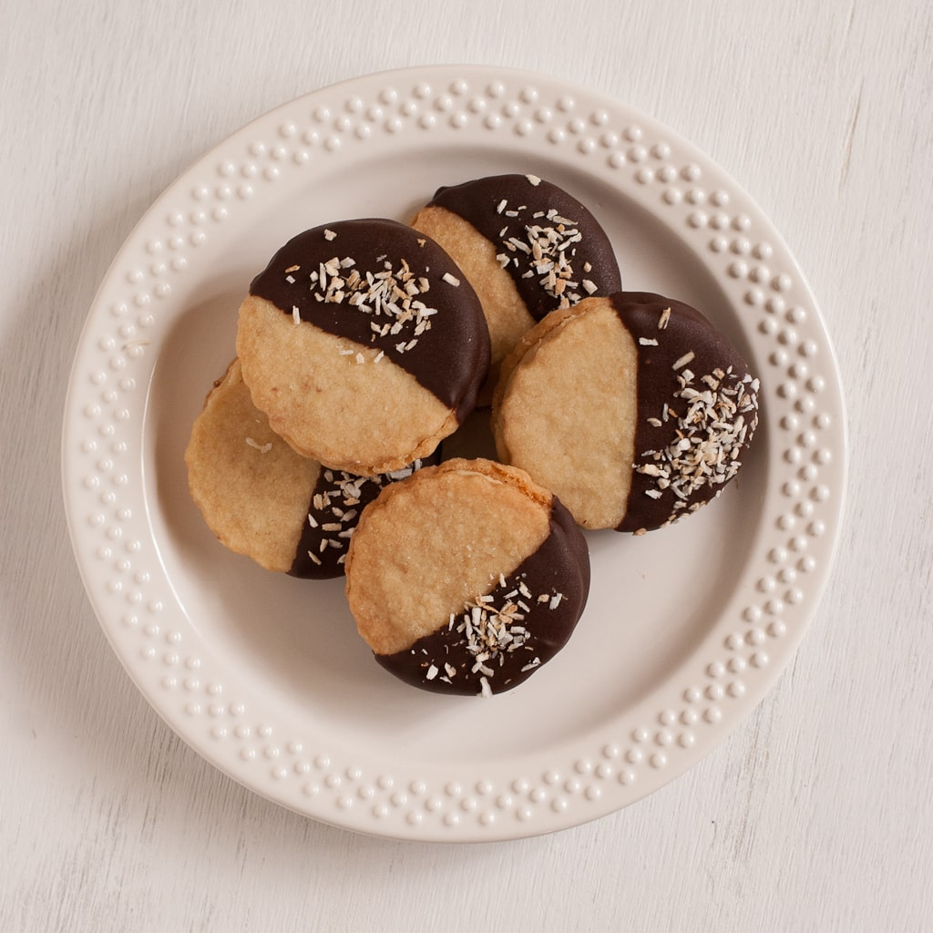 Chocolate Dipped Caramel Cream Filled Coconut Shortbread Cookies PineappleandCoconut.com #leftoversclub