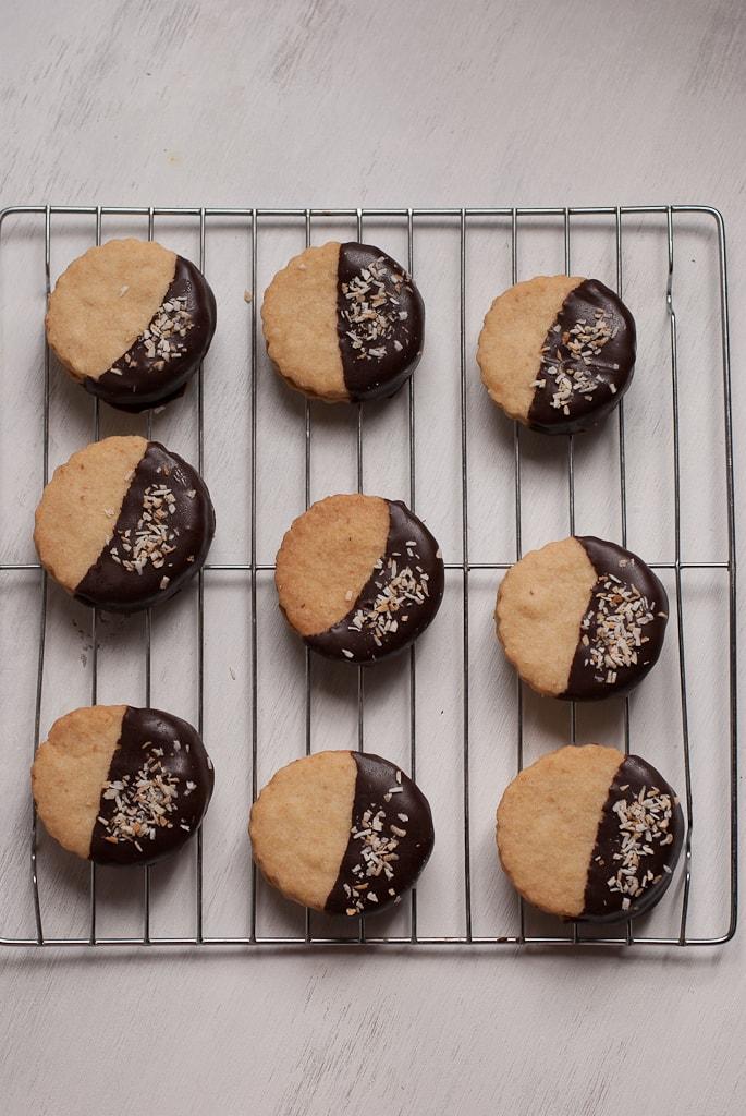 Chocolate Dipped Caramel Cream Filled Coconut Shortbread Cookies PineappleandCoconut.com #leftoversclub