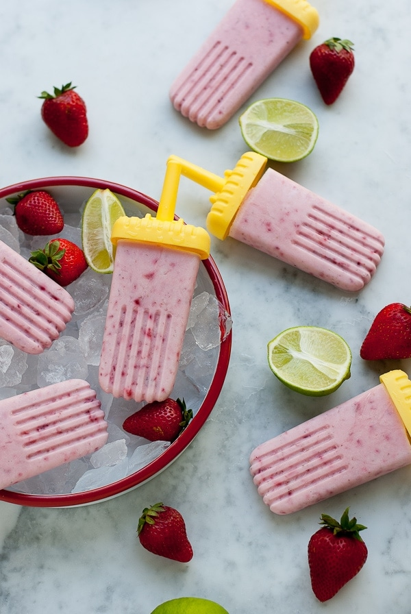 Strawberry Coconut Lime Popsicles. A healthy refreshing treat to cool you down on a hot summer day | www.PineappleandCoconut.com