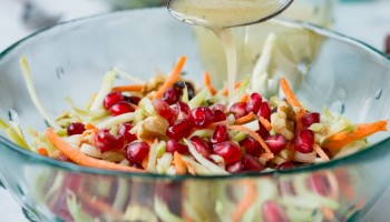 Pomegranate Broccoli Slaw with Avocado Oil Vinaigrette www.pineappleandcoconut.com