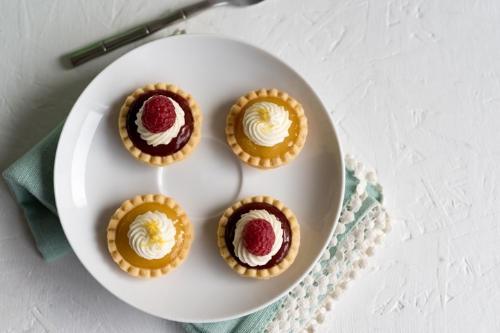 No-Bake Mini Lemon and Raspberry Tarts www.pineappleandcoconut.com #ad #worldmarket #Discover