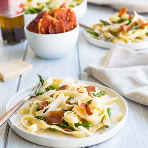 Creamy Preserved Lemon Pasta with Asparagus and Crispy Prosciutto  www.pineappleandcoconut.com #ad #WorldMarket #Easter