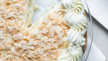 Boozy Coconut Cream Pie www.pineappleandcoconut.com #SlapstickFall #PieFight