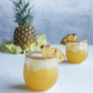 Spiced Pineapple Rum Punch www.pineappleandcoconut.com #drinkmas