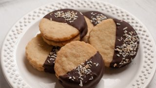 Chocolate Dipped Caramel Cream Filled Coconut Shortbread Sandwich Cookies