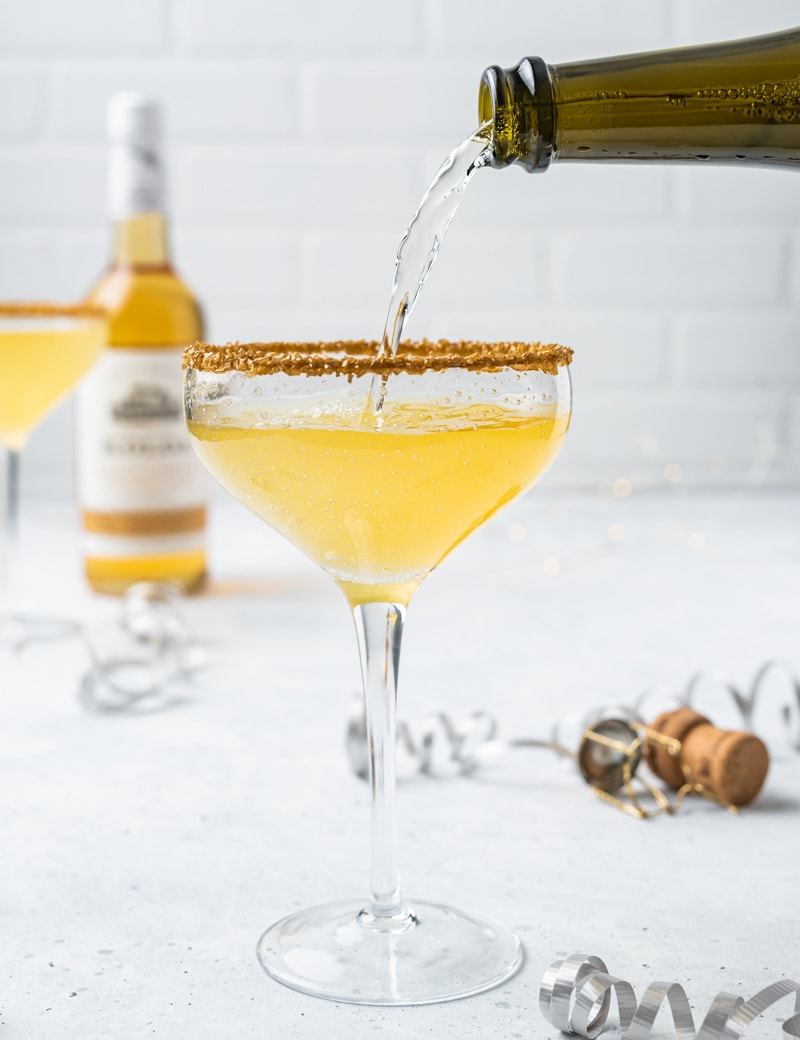 New Year's Golden Tiki Cocktail ( Gold Rum Lychee Champagne Cocktail) Pour pic www.pineappleandcoconut.com