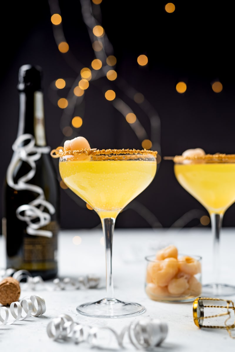 New Year's Golden Tiki Cocktail ( Gold Rum Lychee Champagne Cocktail) www.pineappleandcoconut.com