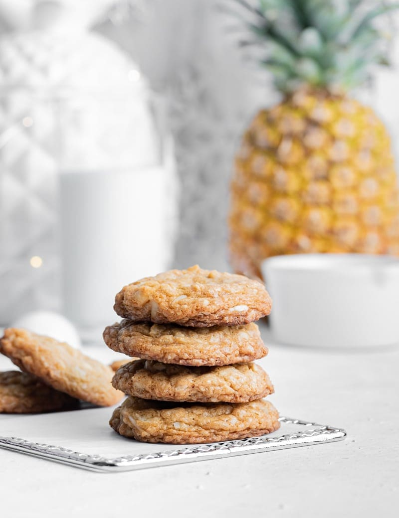 Piña Colada cookies bring a tropical flavor to your cookie tray this holiday season. www.pineappleandcoconut.com