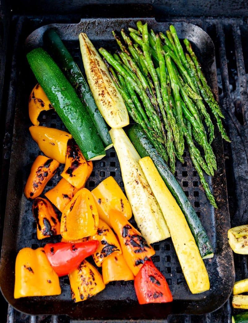 seasoned cut veggies on grill