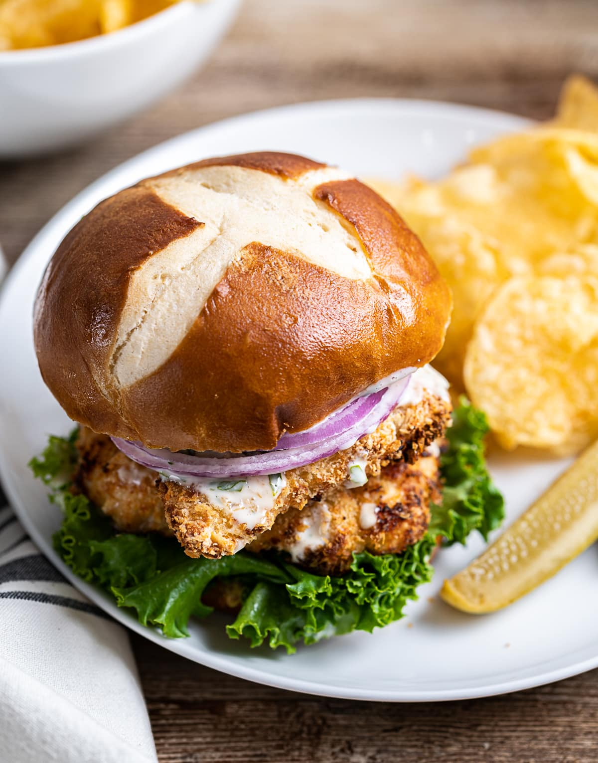 Air Fryer Chicken Schnitzel Sandwiches On Pretzel Buns With Lemon Herb Mayo