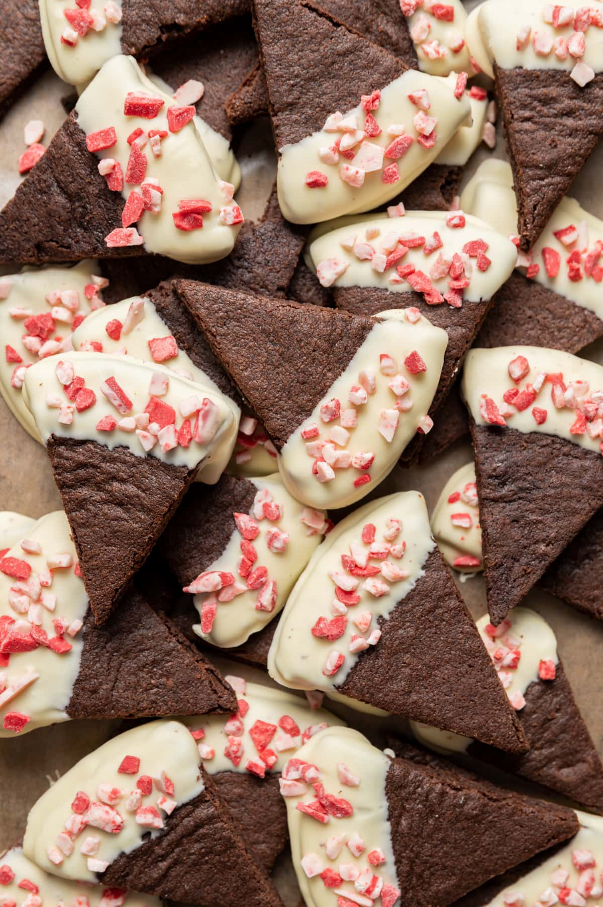chocolate wedge shortbread cookies half dipped in white chocolate sprinkled with peppermint bits