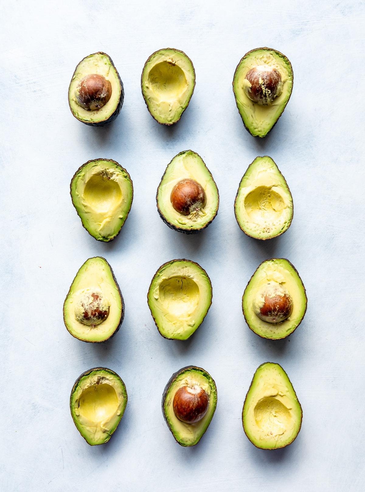 green avocados cut in half